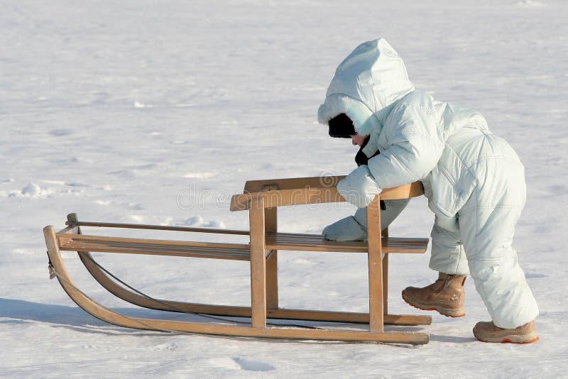 Pushing my sled stock photo