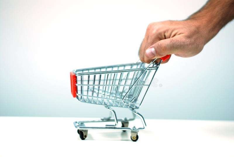 Pushing a shopping cart royalty free stock photos