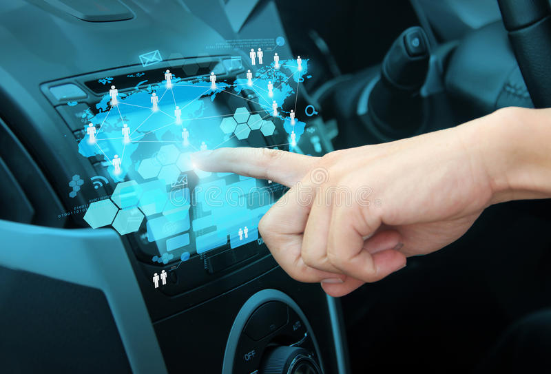 Pushing on a touch screen interface navigation system. In interior of modern car royalty free illustration