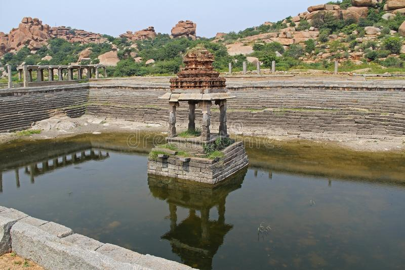 Pushkarani is a sacred lake on the way to the Vitthala temple in Hampi, Karnataka, India. The pond served to the ritual and functi stock images