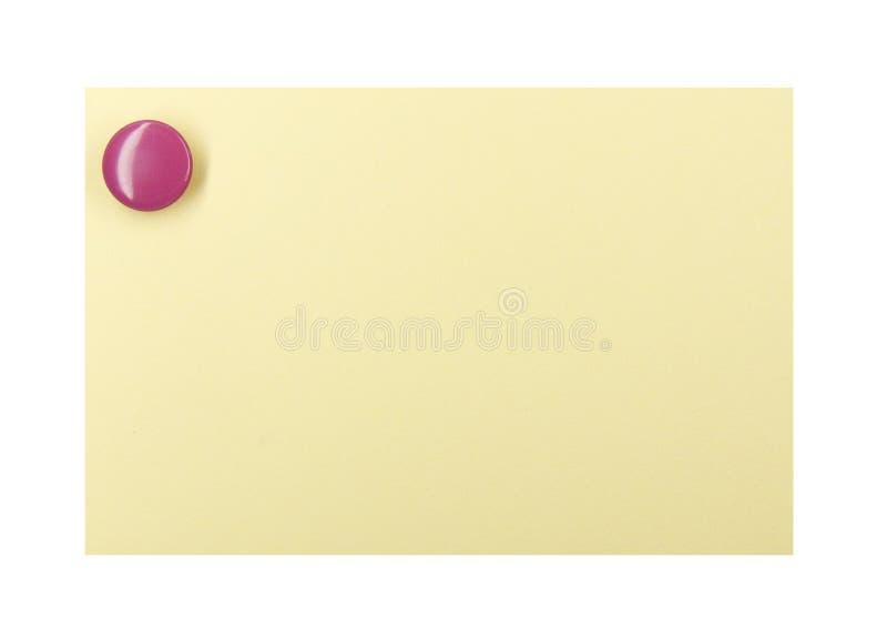 Pushpin em uma nota amarela fotografia de stock royalty free