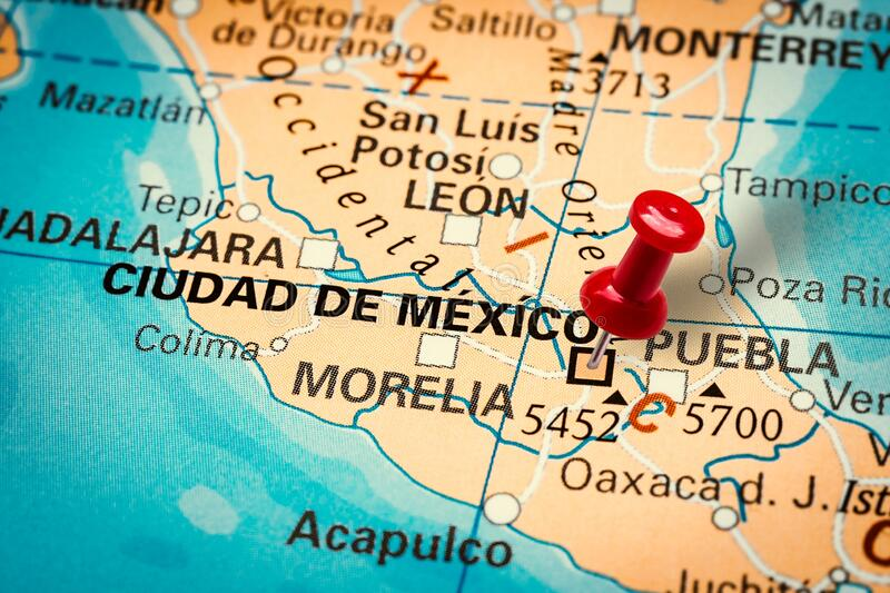 Pushpin pointing at Ciudad de Mexico city in Mexico. PRAGUE, CZECH REPUBLIC - JANUARY 12, 2019: Red thumbtack in a map. Pushpin pointing at Ciudad de Mexico city royalty free stock photo