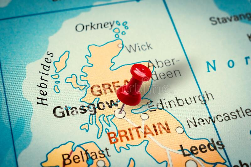 Pushpin pointing at Glasgow city in United Kingdom. PRAGUE, CZECH REPUBLIC - JANUARY 12, 2019: Red thumbtack in a map. Pushpin pointing at Glasgow city in United royalty free stock photography