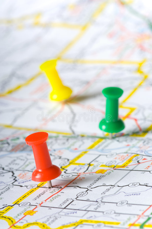 Pushpins on a map royalty free stock image