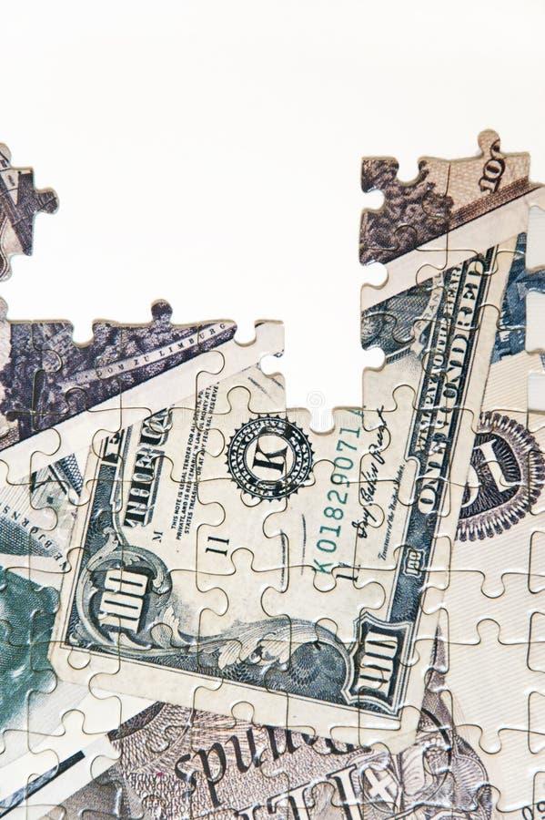 Pussel av pengar arkivfoton