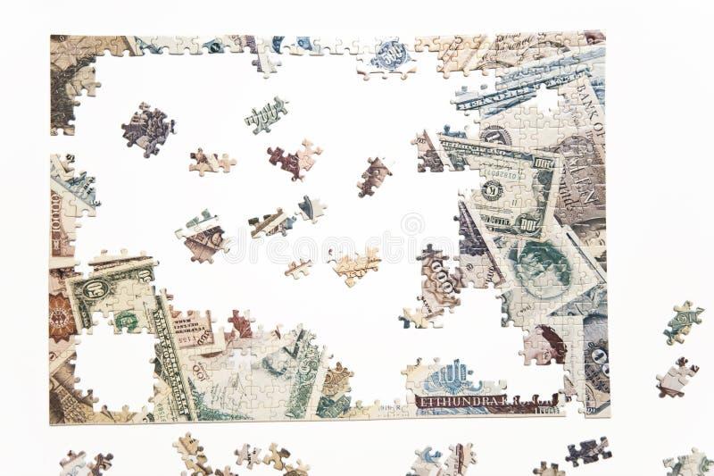 Pussel av pengar arkivfoto