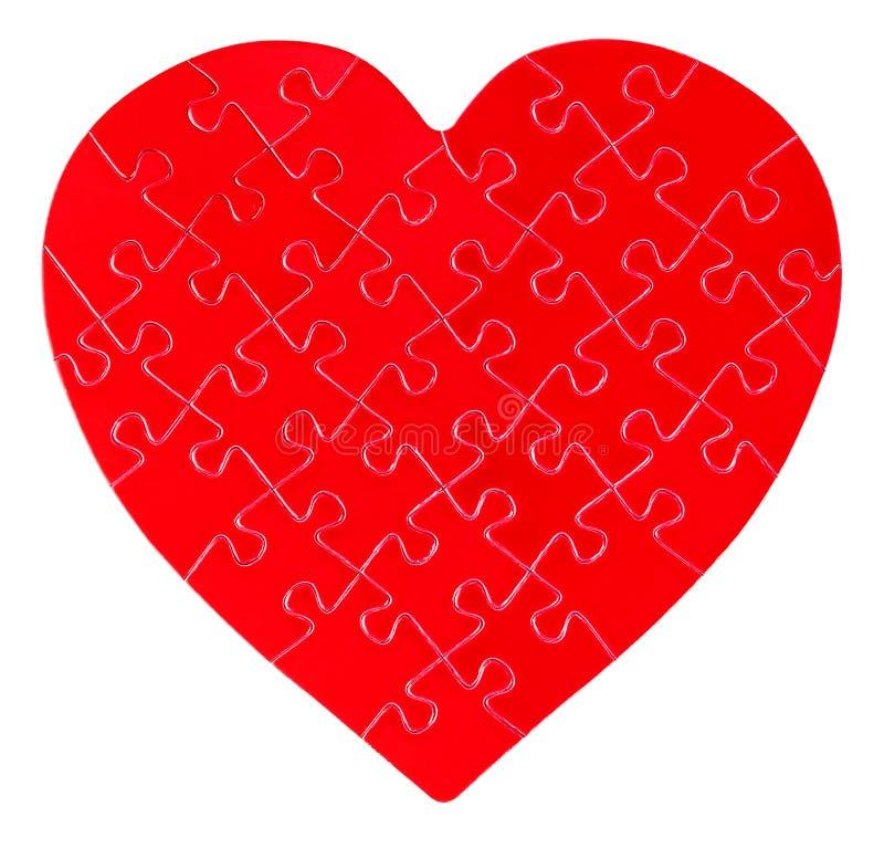 Pussel i en form av en hjärta arkivbild