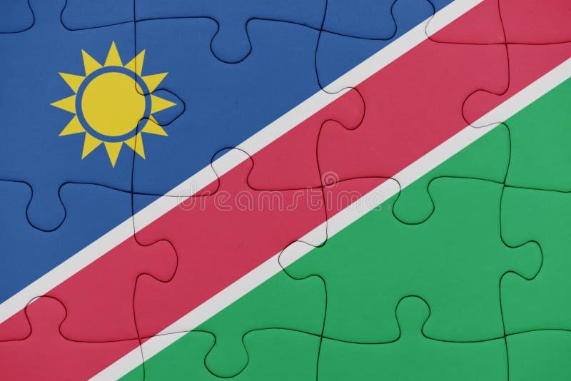 Pussel med nationsflaggan av Namibia stock illustrationer