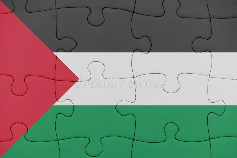 Pussel med nationsflaggan av Palestina arkivfoto