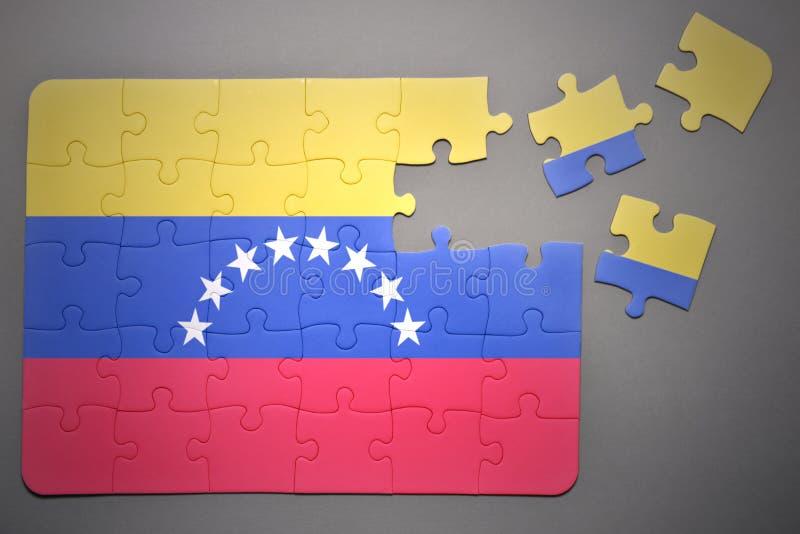 Pussel med nationsflaggan av Venezuela arkivfoton