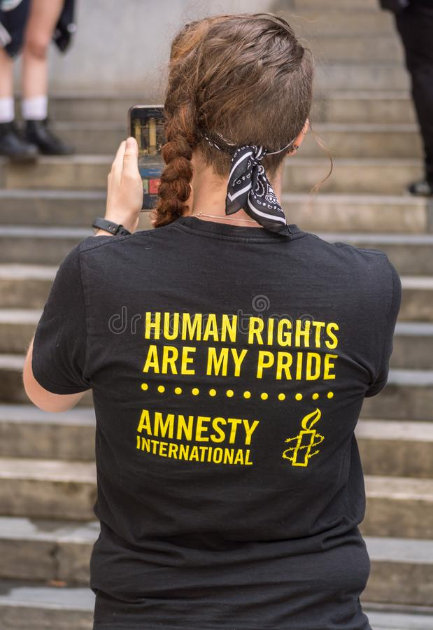 Riot 2019. Adelaide, AU - Mar 6, 2019: Riot, Russian feminist protest punk rock group, at Parliament House in Adelaide for an Amnesty International rally to royalty free stock photography