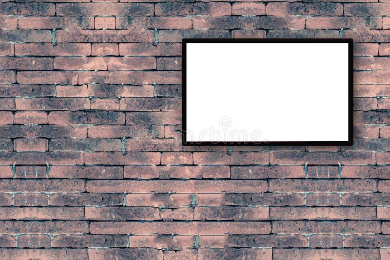 pusta czarna obrazek rama na starym ściana z cegieł z kopii przestrzenią fotografia royalty free