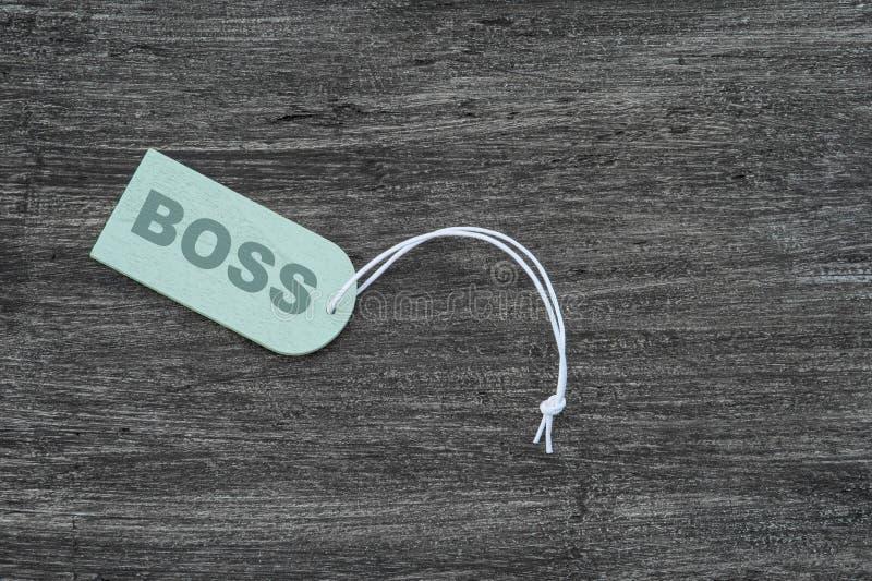 Pusta etykieta Z liną na stole drewnianym Znak, który mówi Boss obraz stock
