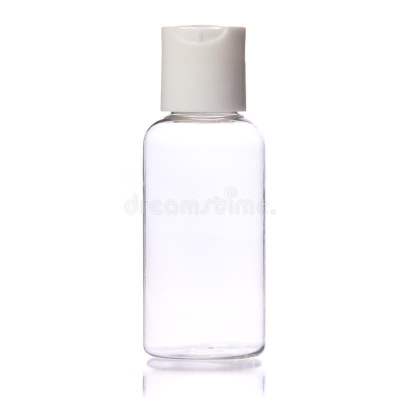 Pusta Jasna butelka na bielu. Kosmetyk. Zdrój fotografia stock