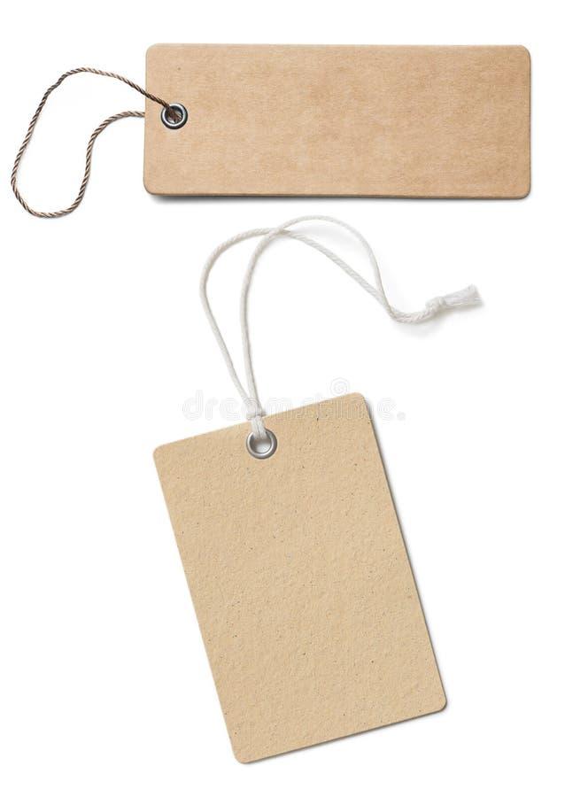 Puste brown kartonowe metki lub przylepiają etykietkę set odizolowywającego obraz royalty free