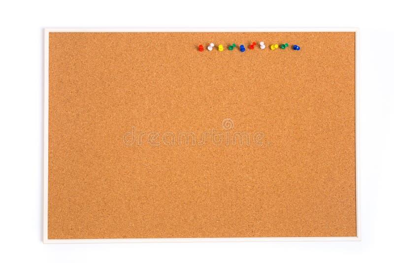 Puste miejsce korka deska z drewnianą ramą i szpilkami obraz stock