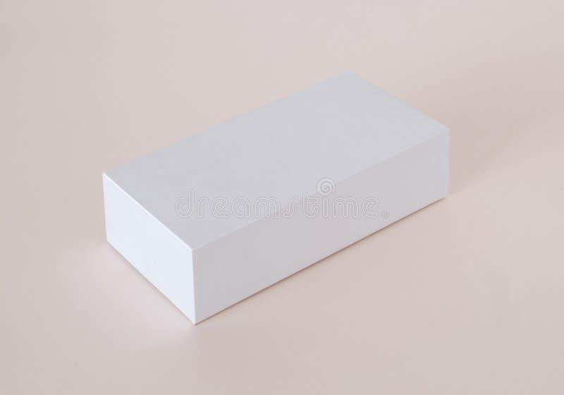 Pusty Biały produktu pakunku pudełko W górę Zbiornik, Pakuje szablon na lekkim tle zdjęcia stock