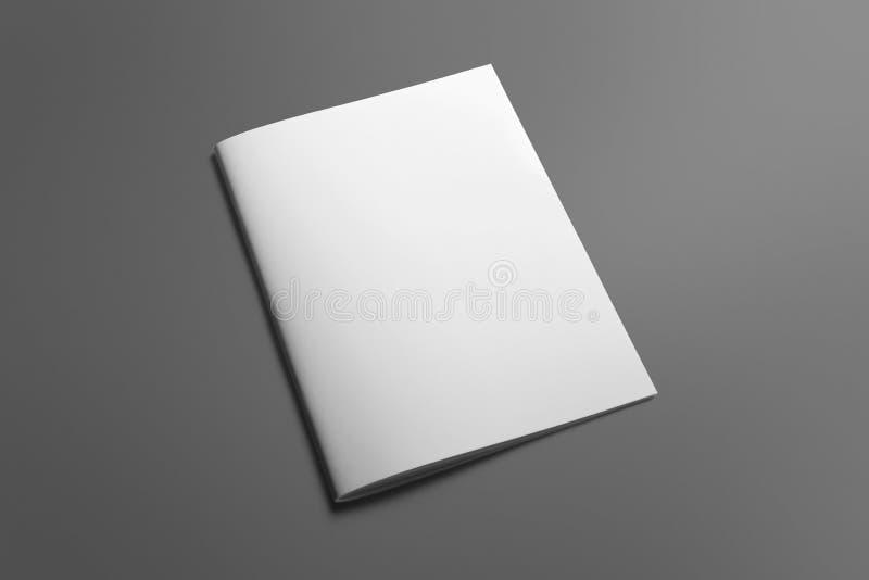 Pusty broszurka magazyn na popielatym zamieniać twój projekt zdjęcia royalty free