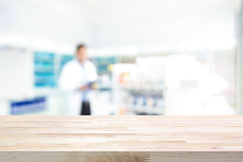 Pusty drewniany odpierający wierzchołek na plamy apteki tle zdjęcia royalty free