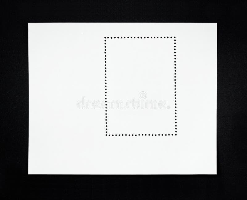 Pusty poczta znaczek na czarnym tle zdjęcie stock