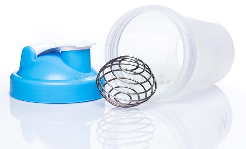 Pusty proteinowy potrząsacz z kruszcową piłką obrazy royalty free
