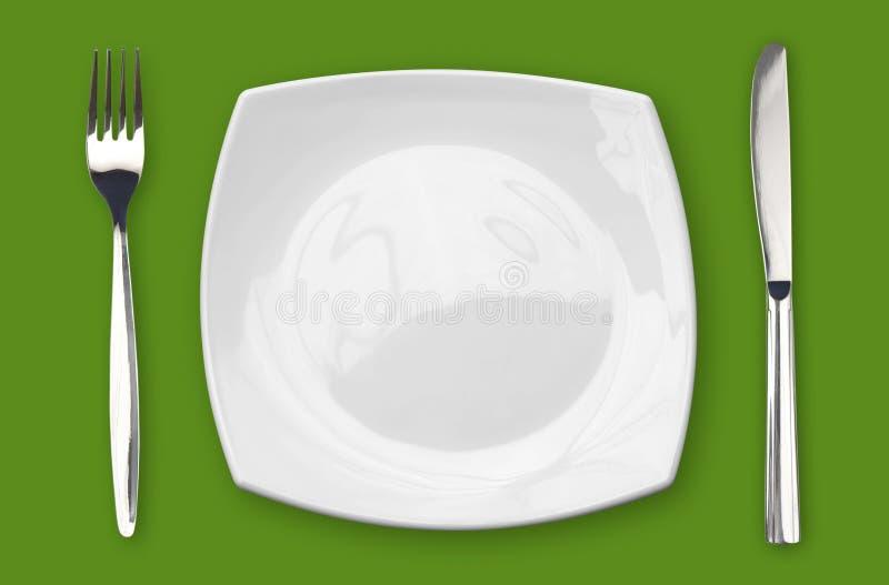 pusty rozwidlenia zieleni noża talerza kwadrata stół fotografia stock