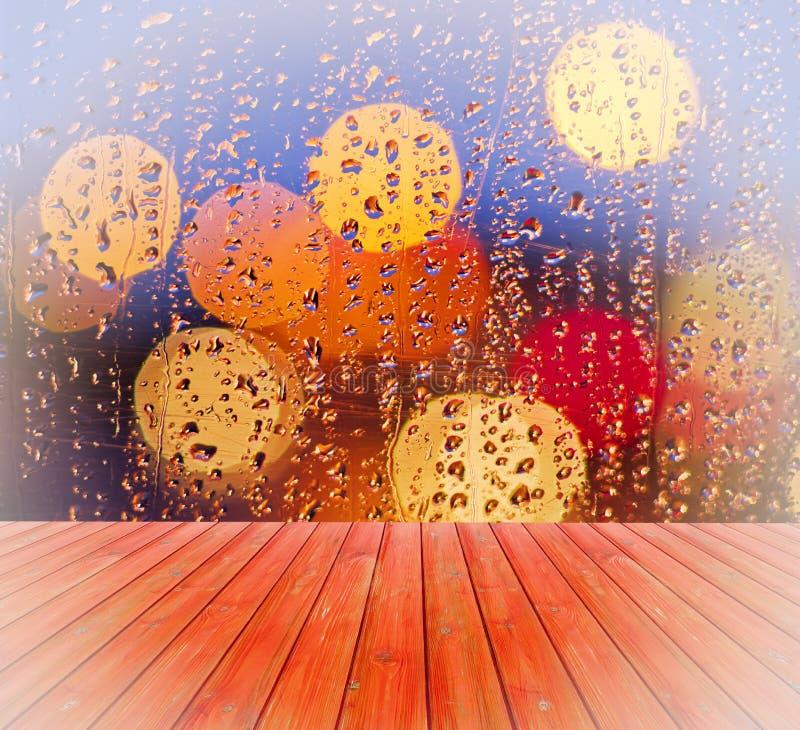 Pusty stół z zamazanym, nadokienny, deszcz opuszcza tło, dla produktu pokazu szablonu royalty ilustracja