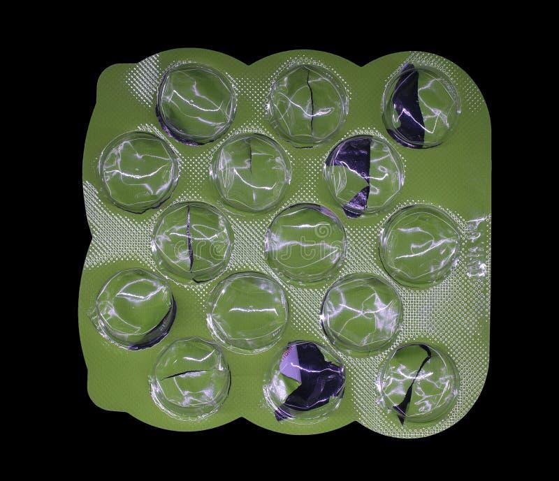 Pusty zielony bąbel od pigułek na czarnym tle obraz stock