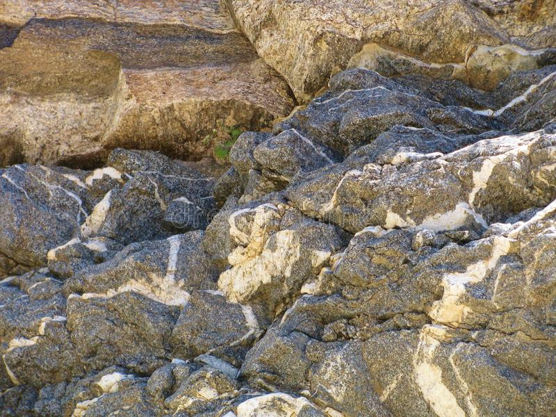 Pustyni skały wielokrotność tekstury i brzmienia tworzą naturalnego abstrakcjonistycznego projekt obrazy stock