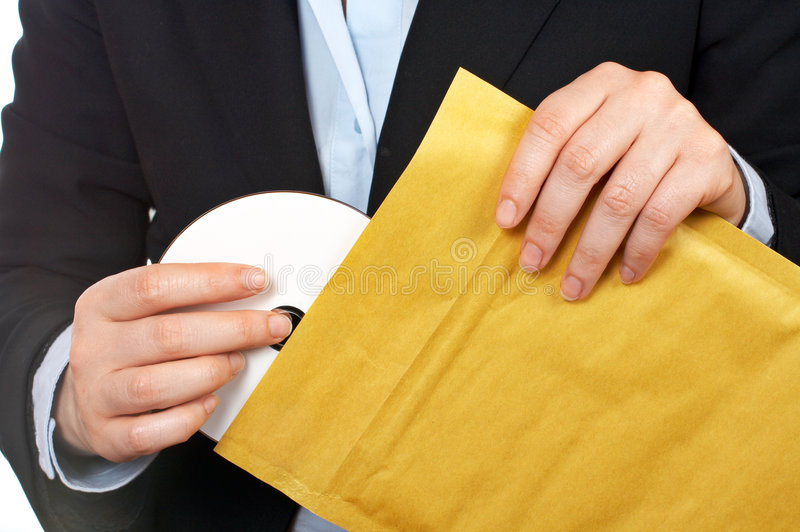 Put dvd disc on the envelope royalty free stock photo