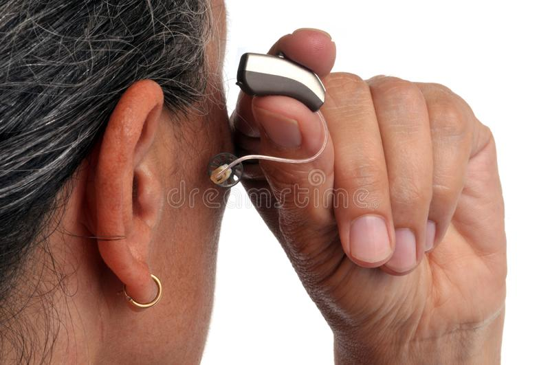 Put a hearing aid in close-up royalty free stock photography