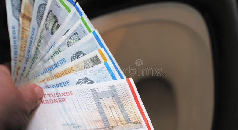 Put money bills in the toilet. Wasting a hand full of money bills down the toilet stock image