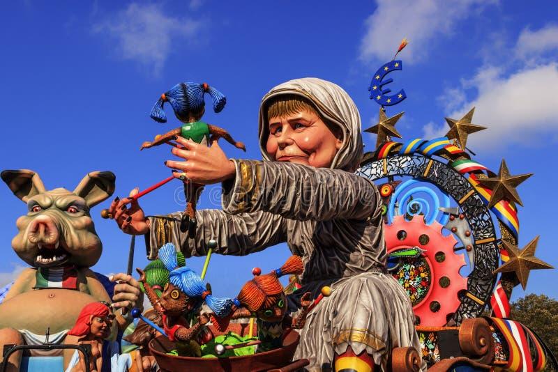 Putignano Carnival: floats. European politicians: Angela Merkel torture Europe.ITALY(Apulia). Putignano,Apulia,Italy - February 15, 2015: carnival floats, giant stock image