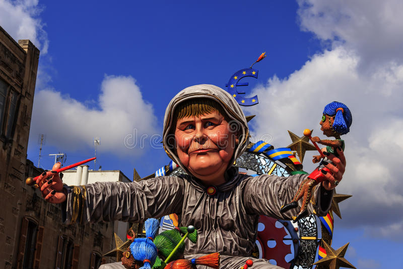 Putignano Carnival: floats. European politicians: Angela Merkel torture Europe.ITALY(Apulia). Putignano,Apulia,Italy - February 15, 2015: carnival floats, giant royalty free stock photos