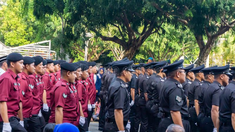 The close up view of the parade contingent marching at the 62nd Independence day or Merdeka Day celebration of Malaysia. stock photo