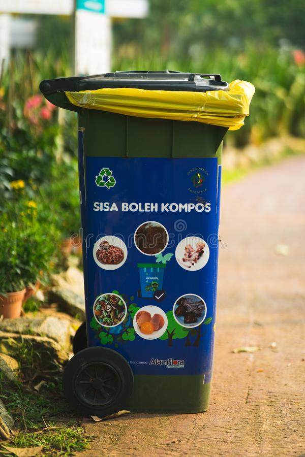 Free Putrajaya, Malaysia - September 6, 2019: Green Plastic Trash Recycling Container With Sticker Saying Compost Trash Only At The Stock Photos - 158399393