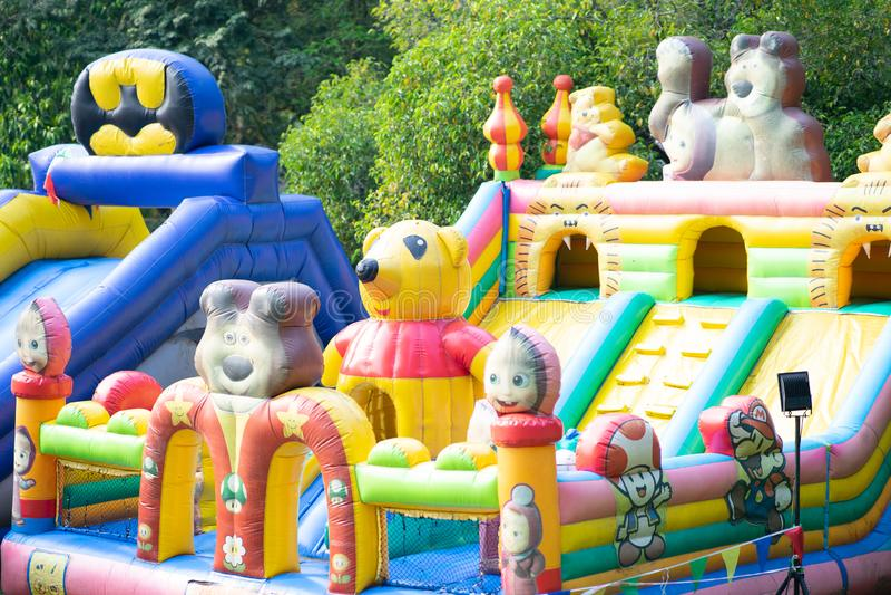 Putrajaya, Malaysia - September 6, 2019 : Children bouncy house with famous cartoon characters at the Royal Floria, Taman Botani. Background, balloon, blue stock photos