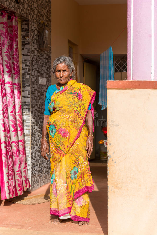 PUTTAPARTHI, ANDHRA PRADESH, INDIA - JULY 9, 2017: An elderly Indian woman in a sari. Copy space for text. Vertical. PUTTAPARTHI, ANDHRA PRADESH, INDIA - JULY 9 stock image