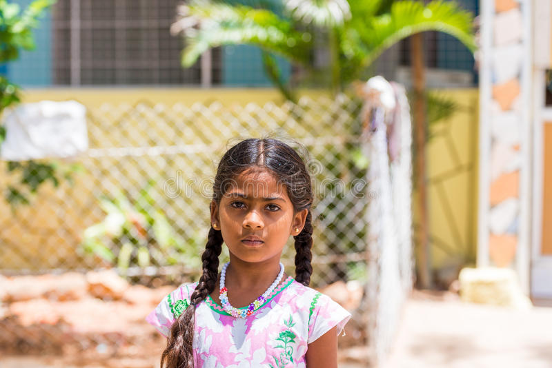 PUTTAPARTHI, ANDHRA PRADESH, INDIA - JULY 9, 2017: Portrait of Indian cute girl on the street. Close-up. Copy space for text. stock photography