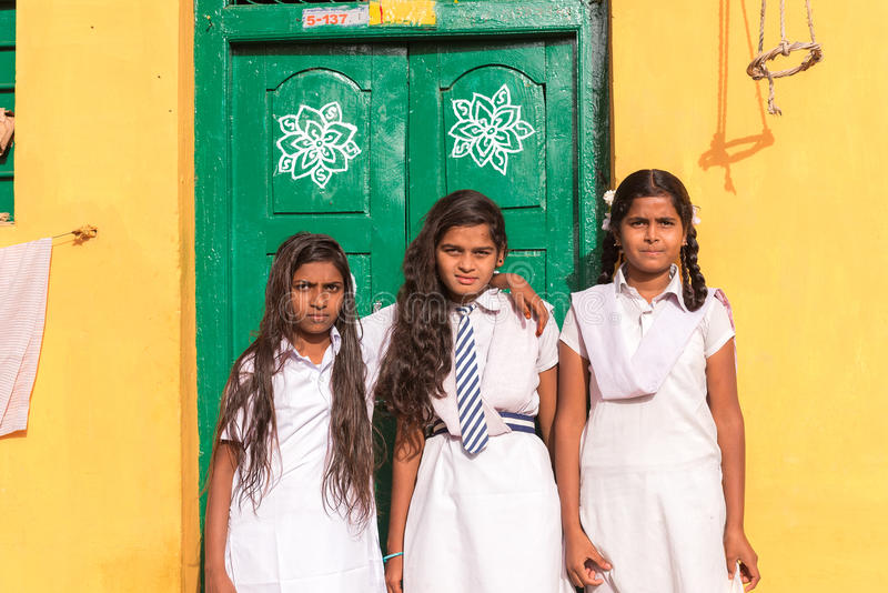 PUTTAPARTHI, ANDHRA PRADESH, INDIA - JULY 9, 2017: Three Indian schoolgirls. Copy space for text. stock photos