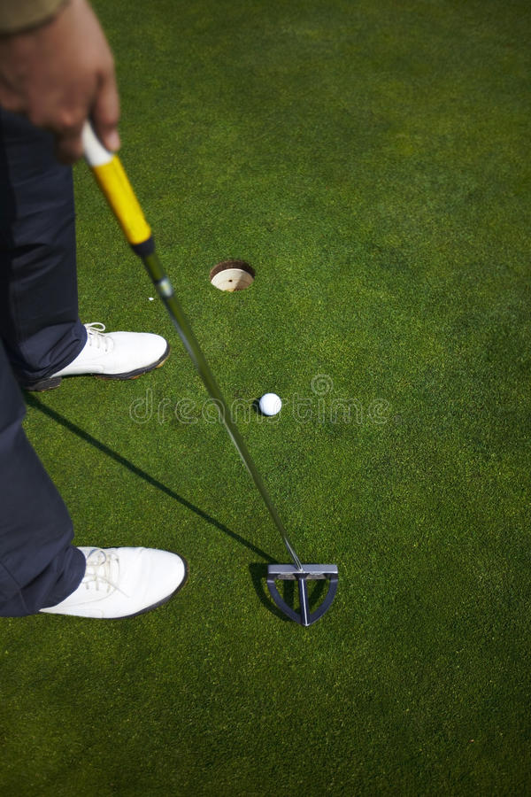 Download Putter With A Golf Ball Aiming Stock Image - Image: 14226101