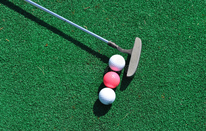 Download Putter And Three Golf Balls Stock Image - Image: 15158595