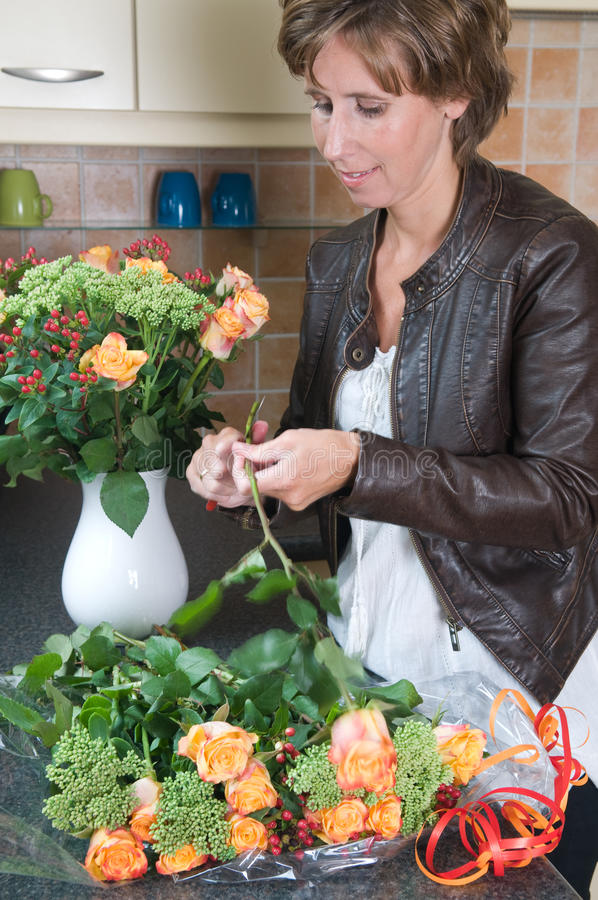 Download Putting flowers in a vase stock image. Image of elegant - 20872181