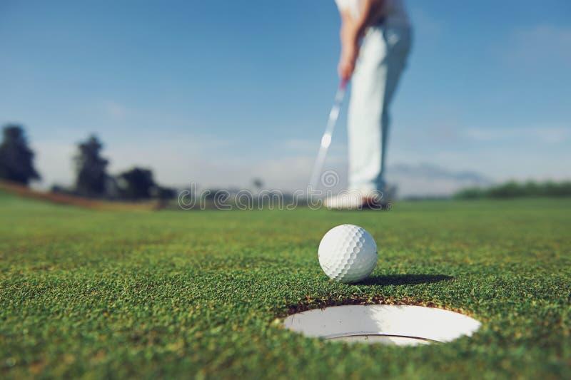 Putting golf man stock images