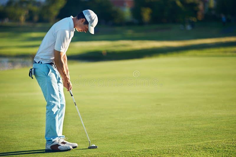Putting golf man stock image