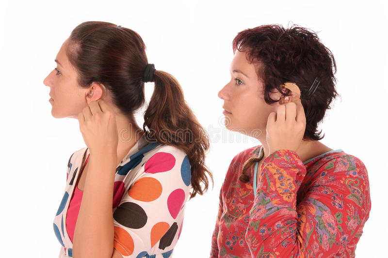 Putting hearing aid into ear royalty free stock image