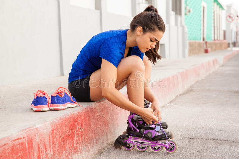 Putting inline skates on royalty free stock photography