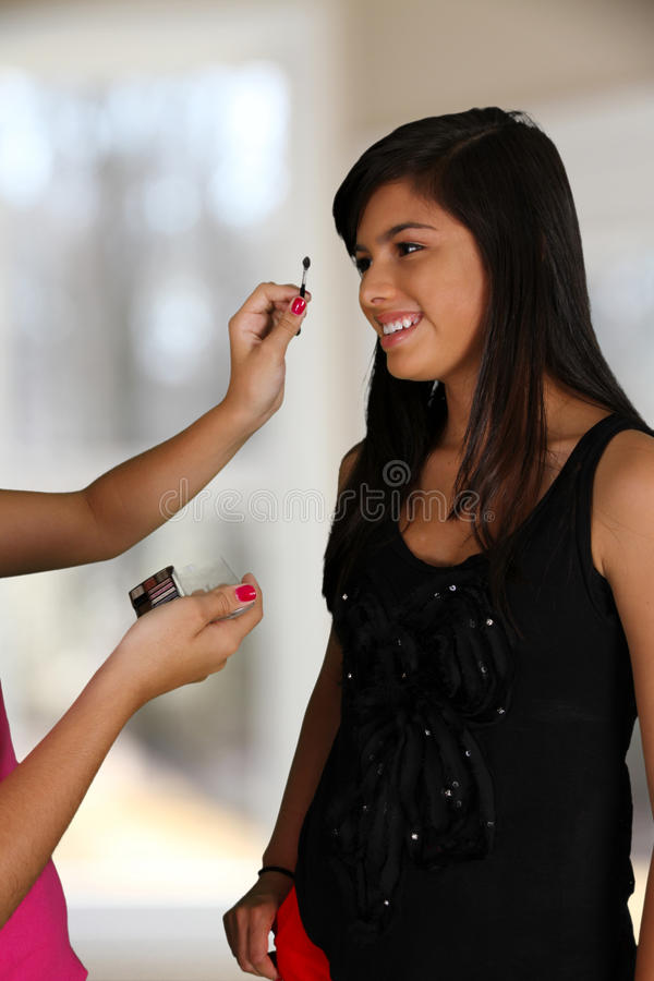 Download Putting On Makeup stock image. Image of person, girl - 25369689