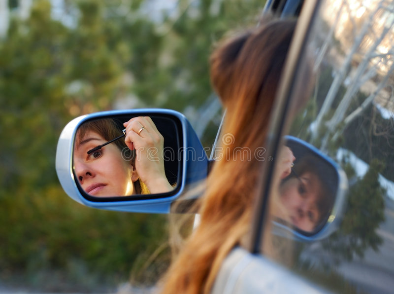 Download Putting makeup on the go stock image. Image of woman, vehicle - 4784621