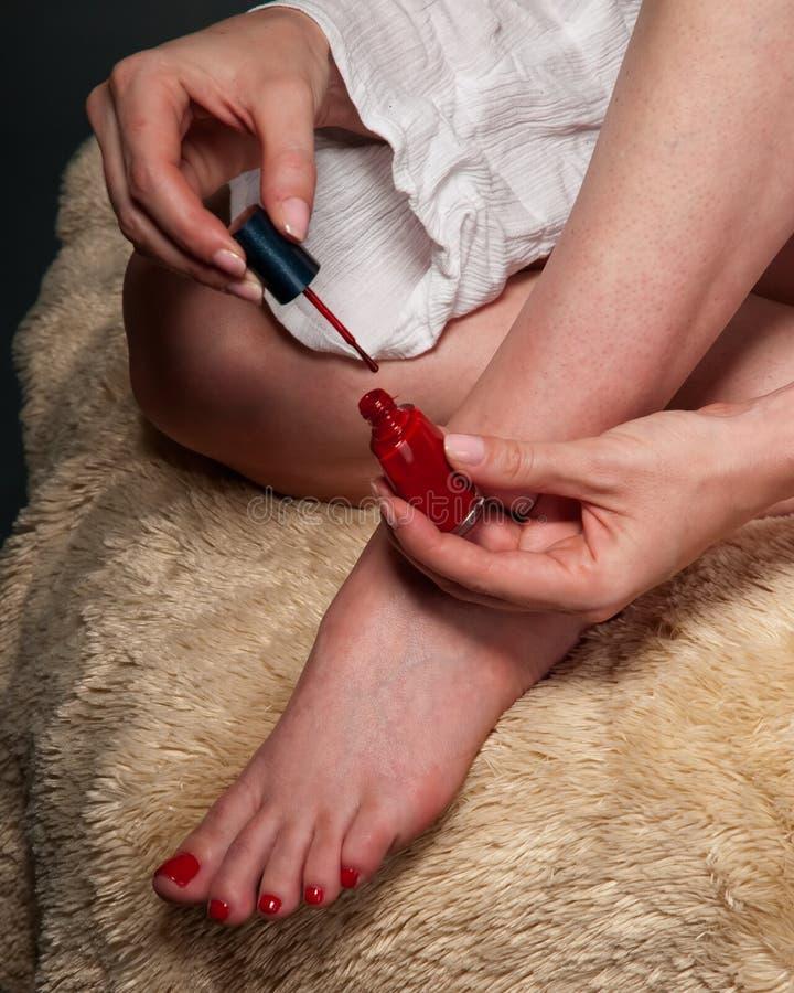 Download Putting on nail polish stock image. Image of woman, adult - 8418133